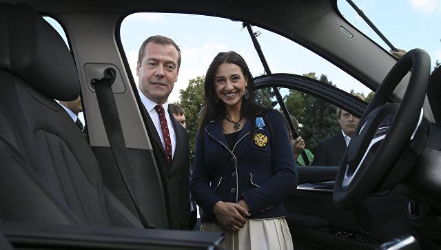 какие авто получат российские олимпийские чемпионы в рио поднимаю свой бокал